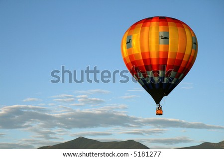 Hot air balloon in morning light - stock photo