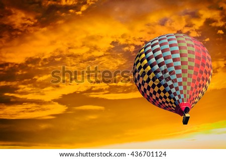 Hot air balloon in the sky at sunset.