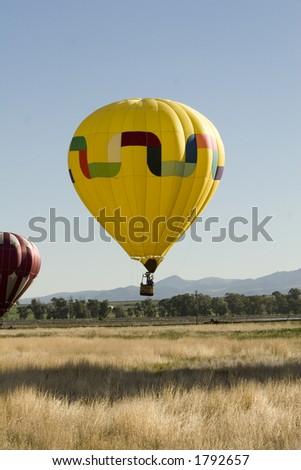 Hot Air Balloon landing - stock photo