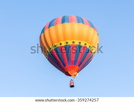 Hot air balloon on blue sky background