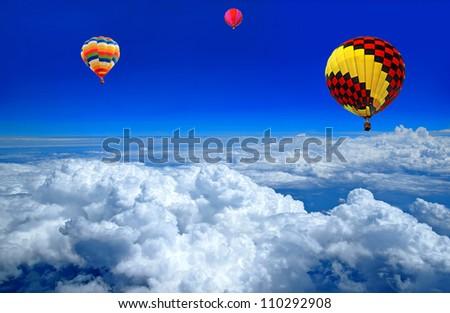 Hot air balloon on the cloud - stock photo