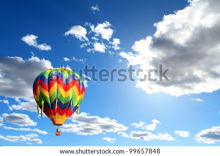 hot air balloon over cloudy sky - stock photo