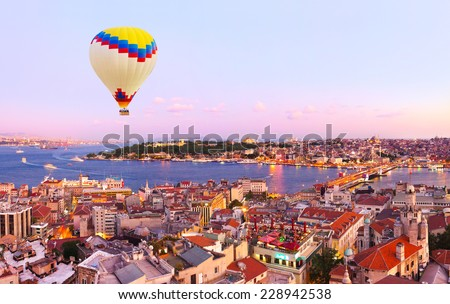 Hot air balloon over Istanbul sunset - Turkey travel background - stock photo