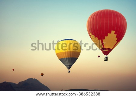 Hot air balloon over mountain on sky sunset , vintage and retro filter effect style - stock photo