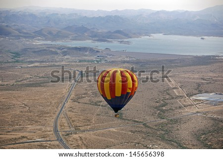 Hot Air Balloon over the Arizona desert near Lake Pleasant - stock photo