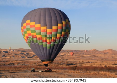 Hot Air Balloon, Popular Activity, landing on pick-up car at Cappadocia, Turkey. Cappadocia is famous as one of the best place for Balloon.