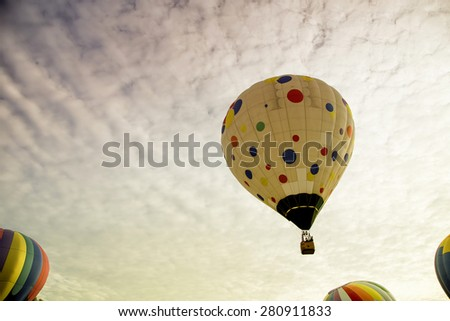 Hot air balloon rising up to the enchanting morning sky