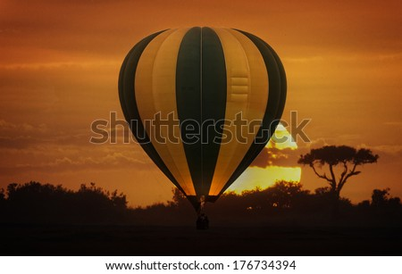Hot air balloon safari flight in the magnificent setting of the Great Rift Valley in Kenya - stock photo