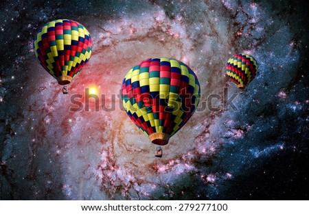 Hot air balloon surreal landscape magical fantasy fairy tale. Elements of this image furnished by NASA. - stock photo