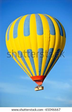Hot air balloon tour against a blue sky - stock photo