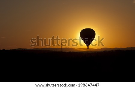 hot air ballooning silhouettes in the sunset