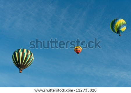 Hot air balloons against a blue sky, Reno, Nevada - stock photo