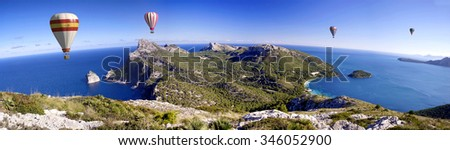 hot air balloons and blue sky in formentor - stock photo
