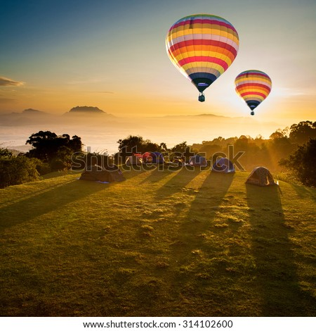 Hot air balloons and winter Viewpoint on mountain northern Chiang Mai ,Thailand  - stock photo