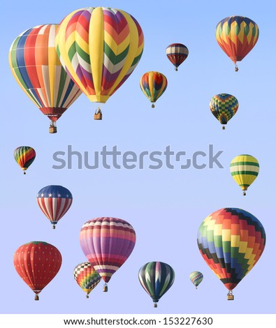 Hot-air balloons arranged around edge of frame allowing space for text in the center of blue sky - stock photo