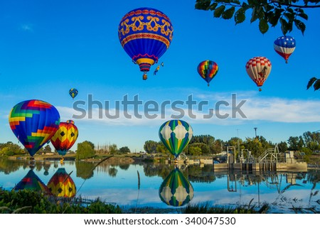 Hot Air Balloons/Balloons/Balloons dipping into the river - stock photo