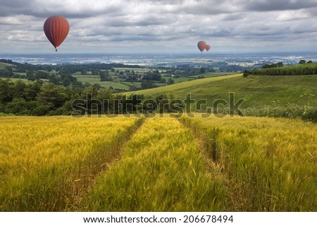 Hot air balloons drifting over the East Yorkshire Wolds in the United Kingdom