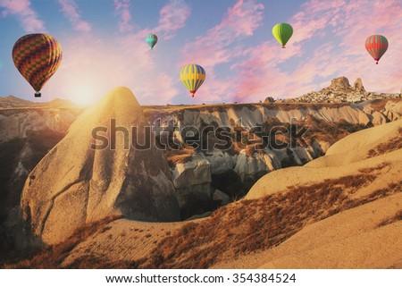 Hot air balloons flying over cappadocia. - stock photo