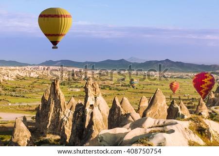 Hot air balloons flying over Cappadocia, Turkey - stock photo