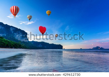 Hot-air balloons flying over sunset on the beach. Ao-Nang. Krabi. Thailand
