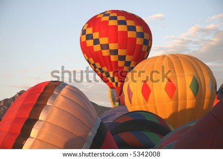 Hot air balloons in early morning light - stock photo
