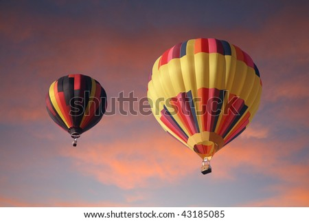 Hot-air balloons in the sunset - stock photo