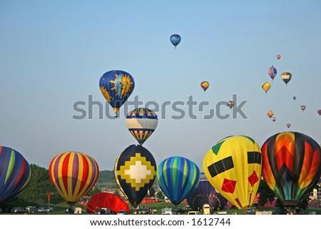 Hot Air Balloons Lifting Off - stock photo
