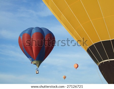 Hot air balloons on the blue sky participating in the Malaysia Hot Air Balloon Festival - stock photo