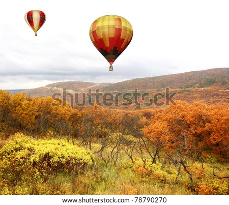 Hot Air Balloons Over Autumn Landscape