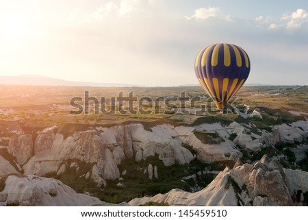Hot air balloons rise over Goreme town in Cappadocia, Turkey