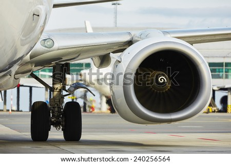 Hot air behind the aircraft engine - selective focus - stock photo