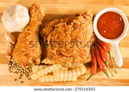 Hot and crispy fried chicken, french fries, chili, garlic and black pepper