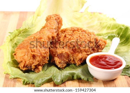 Hot and crispy fried chicken legs with chili and vegetable - stock photo