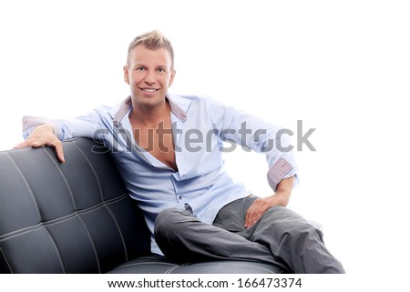 Hot and sexy guy having a photo session in studio