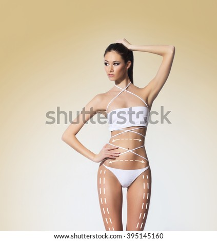 Hot and sexy woman in swimsuit. Plastic surgery concept. - stock photo