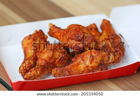 Hot and Spicey Buffalo Chicken Wings in cardboard delivery box