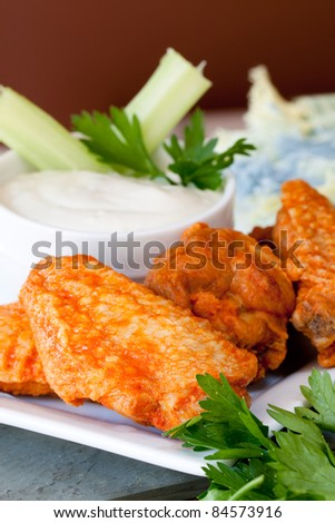 Hot and Spicy Buffalo Wings with Blue Cheese Dipping Sauce - stock photo