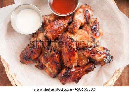 hot and spicy chicken wings with dip and hot sauce - stock photo
