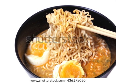 Hot and spicy instant noodle on isolated background - stock photo
