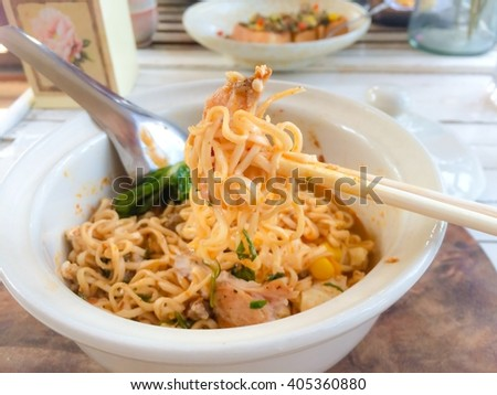 Hot and Spicy Instant Noodles serve on white bowl, soft tone