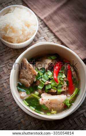 hot and spicy pork rib hot pot with tamarind and Thai herbs - stock photo