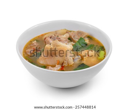 hot and spicy soup with pork isolated on white background - stock photo