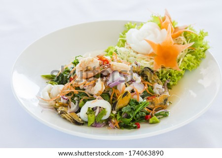 Hot and Spicy Thai Style Seafood salad with fern leaves