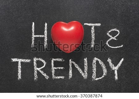 hot and trendy phrase handwritten on blackboard with heart symbol instead of O