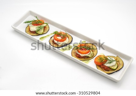 Hot appetizer with fried eggplant isolated on white - stock photo