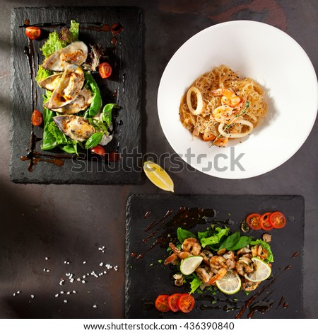 Hot Appetizers on Black Stone Background - stock photo