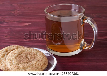 Hot Apple Cider and Snickerdoodle Cookies on a Red Wooden Background