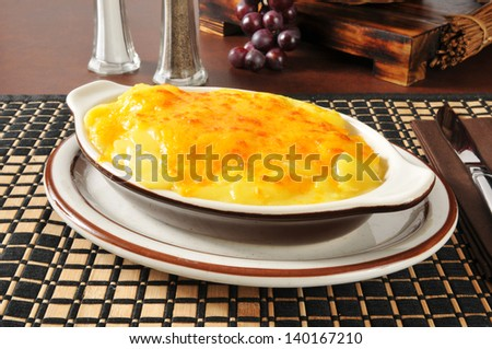 Hot au gratin potatoes in a casserole dish