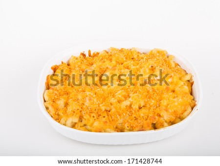 Hot, baked, macaroni and cheese in a white casserole - stock photo