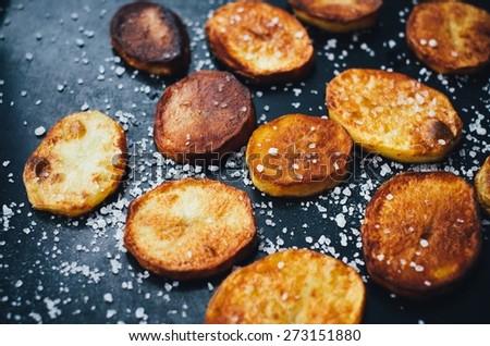 Hot Baked Potatoes On A Baking - stock photo